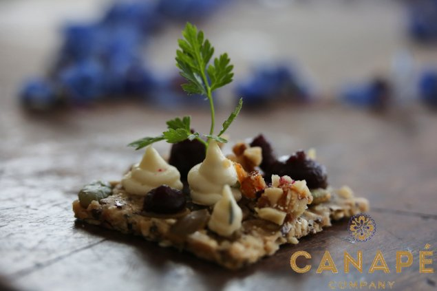 Canape seeded lavosh topped with chived goats cheese, beet gel, and caramelised walnut